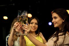 People with champagne in a bar or casino having lots of fun stock photo
