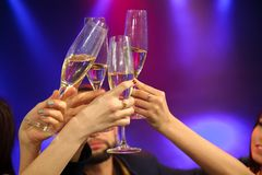 People with champagne in a bar or casino having lots of fun royalty free stock photos