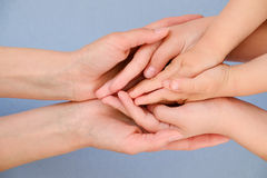 People, charity, family and care concept - close up of woman hands holding girl and boy hands. People, charity, family and care concept - close up of woman hands royalty free stock photo