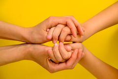 People, charity, family and care concept - close up of woman hands holding girl hands Royalty Free Stock Photos