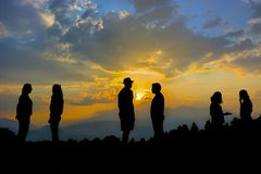 People chatting at sunset. Silhouette-people chatting at sunset stock photos