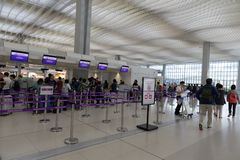 Low-cost airline HK Express. People at the check-in counter of HK Express. It is a Hong Kong-based low-cost airline Royalty Free Stock Image