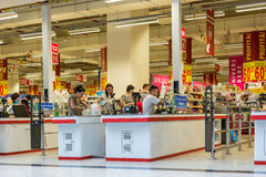 People Check Out At Local Supermarket. BUCHAREST, ROMANIA - JUNE 14: People Check Out At Local Supermarket on June 14, 2014 in Bucharest, Romania Stock Images