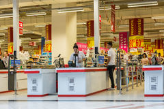 People Check Out At Local Supermarket. BUCHAREST, ROMANIA - JUNE 14: People Check Out At Local Supermarket on June 14, 2014 in Bucharest, Romania Royalty Free Stock Photo