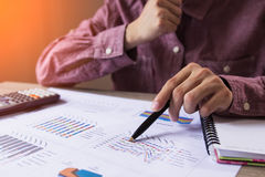 People check profit fund graph about cost at home. Finance managers task,Concept business and finance Stock Photos
