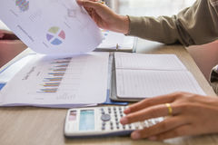 People check profit fund graph about cost at home. Finance managers task,Concept business and finance Royalty Free Stock Image