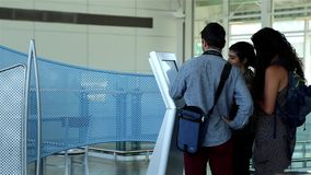 People checking map at direction sign stock footage