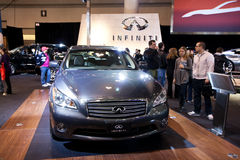People checking out the new Infiniti M series Stock Images