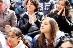 People cheer up. Unidentified fans cheer up during pop singer Bengu Erden performs live at Marmara Egitim Kurumlari on April 23, 2011 in Istanbul, Turkey Stock Images