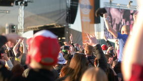 People Cheering to Music. People cheering and dancing to music at open air music festival stock footage