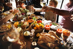 People Cheers Celebrating Thanksgiving Holiday Concept.  stock photo