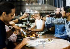 People cheers a wine glasses together Stock Photo