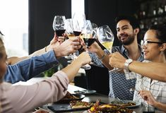 People cheers a wine glasses together royalty free stock image