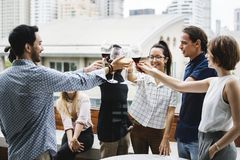 People cheers a wine glasses together Royalty Free Stock Photography