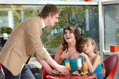 People with child in cafe. Stock Images