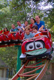 People-Children and Adults on a Amusement Park Roller Coaster Royalty Free Stock Images