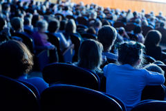 People, children, adults, parents in the theater watching the performance Royalty Free Stock Photos