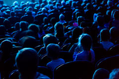 People, children, adults, parents in the theater watching the performance Stock Images
