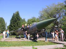 People children playing near the monument military combat aircraft in the Park in the summer royalty free stock photo