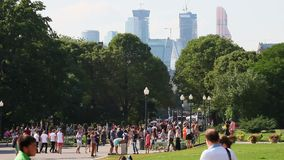 People and children relax on attraction in the city in park on the streets of Moscow stock footage