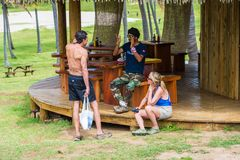 People of Chile. EASTER ISLAND, CHILE - NOV 9, 2014: Unidentified Chilean man says something to the tourists. Chilean people are of mixed Spanish and Amerindian Royalty Free Stock Photos
