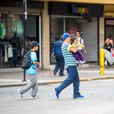 People of Chile. SANTIAGO, CHILE - NOV 1, 2014:  Unidentified Chilean man carries his baby. Chilean people are mainly of mixed Spanish and Amerindian descent Royalty Free Stock Photos
