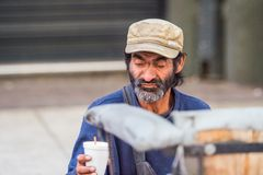 People of Chile. SANTIAGO, CHILE - NOV 1, 2014:  Unidentified Chilean poor man in the street in Santiago. Chilean people are mainly of mixed Spanish and Stock Photography
