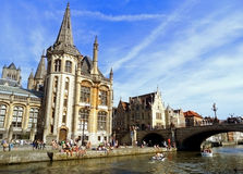 People chilling out at riverside In the afternoon of Sunday 18th May 2014, Ghent Historic Center, Belgium Stock Photo