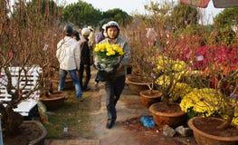 People choice flowerpot at open air farmer market. DALAT, VIETNAM- JAN 26: People pleaed when choice flowerpot at open air farmer market, flower in pot, blossom Stock Photo