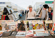 People choose art and photo books at the book market. PRAGUE: Many people choose art and photo books at the indoor book market in Czech Republic. Fourteenth Royalty Free Stock Photography