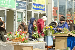 People choose flowers in a gift on March 8 Royalty Free Stock Photo