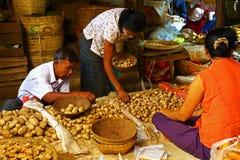 People choose potatoes in a market, Myanmar Royalty Free Stock Photos