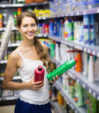 People choose some detergents in the shop Royalty Free Stock Photography
