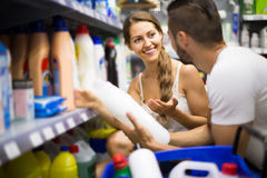 People choose some detergents in the shop Royalty Free Stock Images