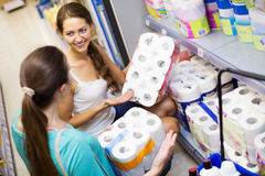 People choose toilet paper in shop Royalty Free Stock Photos
