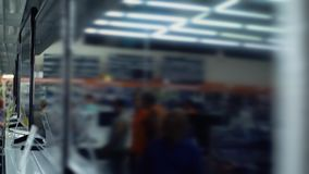 People choose TVs in the consumer electronics supermarket. People choose TVs in consumer electronics supermarket stock footage