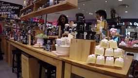 People choosing gift inside body shop store. stock footage