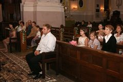 People in christianity church. LUTSK, UKRAINE - 26 July 2009: People believe faith religious in christianity church Stock Photos