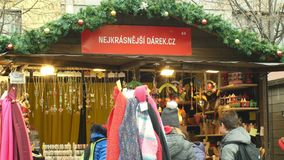 Brno, Czech Republic, December 21, 2018: People at the Christmas advent market stall at the square, sale of gifts of. People at the Christmas advent market stall stock video