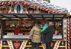 People at Christmas candy house in Vilnius Lithuania. Vilnius, Lithuania - December 4, 2016: People at Christmas candy house on Xmas market on Cathedral Square stock image