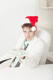 People in Christmas hat gives us money Stock Image