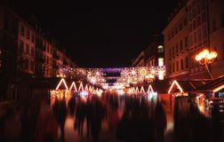 People in the Christmas market buying gifts - motion blur Stock Image