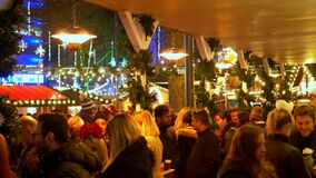 People at Christmas Market on Leicester Square - LONDON, ENGLAND - DECEMBER 10, 2019