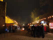 People at Christmas market at old castle by night Stock Photography