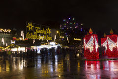 People at Christmas markets in Vienna in front of the town hall at night. Stock Photography