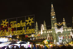 People at Christmas markets in Vienna in front of the town hall at night. Stock Photos