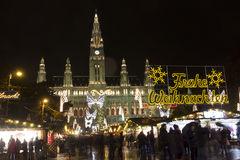 People at Christmas markets in Vienna in front of the town hall at night. Royalty Free Stock Image