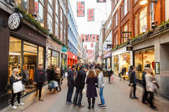 People Christmas shopping on Carnaby Street, London. Stock Photography
