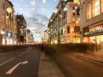 People Christmas shopping with motion blur on Oxford Street, Chr Royalty Free Stock Images