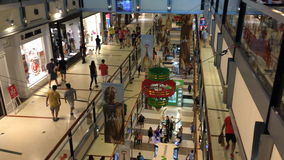 People Christmas shopping at three levels in Buenos Aires shopping mall at high speed stock footage